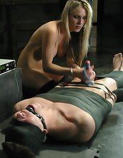 Mistress Harmony has her bitch boy all tied up and wired with electrodes. She enjoys seeing him writhe in fear and agony, it makes her want to turn the voltage up even higher. She does what she pleases with her slave, mummified he can barely move. Electri